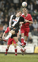 Photo: Aidan Ellis.<br /> Grimsby Town v Swindon Town. Coca Cola League 2. 17/03/2007.<br /> Swindon's Jack Smith beats Grimsby's Gary Jones to the header