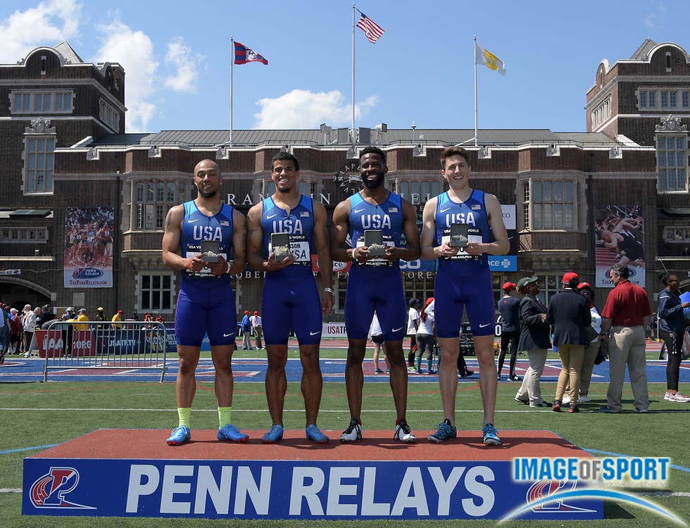 Apr 28, 2018; Philadelphia, PA, USA; Members of the USA Red sprint medley relay pose after winning the USA vs. The World race in 3:14.91 during the 124th Penn Relays at Franklin Field. From left: Cordero Gray, Bryce Robinson, Jevon Hutchinson and Jesse Garn.