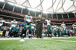 Philadelphia Eagles defensive end Trent Cole #58, Head Coach Andy Reid, quarterback Michael Vick #7 during the singing of the national anthem before the NFL game between the Philadelphia Eagles and the Atlanta Falcons on December 7th 2009. The Eagles won 34-7 at The Georgia Dome in Atlanta, Georgia. (Photo By Brian Garfinkel)