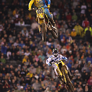 Ronnie Stewart, (top), Suzuki, and Joshua Hill, Suzuki, in action during the final of the 450SX Class Championship during round 16 of the Monster Energy AMA Supercross series held at MetLife Stadium. 62,217 fans attended the event held for the first time at MetLife Stadium, New Jersey, USA. 26th April 2014. Photo Tim Clayton