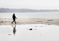 May 2, 2019 - Toronto, ON, Canada - TORONTO, ON - May 2    A woman walks along the deserted and somewhat flooded beach in Bluffers Park in Scarborough.  Flooding and cool, wet weather threatens many areas in Ontario and Quebec including parts of the GTA.May 2, 2019 Richard Lautens/Toronto Star (Credit Image: © Richard Lautens/The Toronto Star via ZUMA Wire)