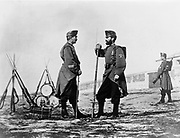 Three Spanish soldiers, full-length portrait, standing, with bayoneted rifles and drums. photographic print : albumen. [between 1860 and 1880]