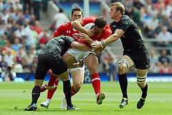 Photo © SPORTZPICS / SECONDS LEFT IMAGES 2011 - Rugby Union - Investic - World Cup warm up game - England V Wales - 06/08/11 - Wales' Jamie Roberts on the charge is stopped by two England players inc Tom Croft (R) in the first half - at Twickenham Stadium UK - All rights reserved
