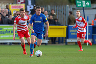 AFC Wimbledon midfielder Anthony Hartigan (8) dribbling during the EFL Sky Bet League 1 match between AFC Wimbledon and Doncaster Rovers at the Cherry Red Records Stadium, Kingston, England on 9 March 2019.