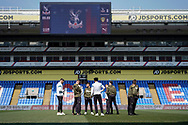 Leeds United U23 inspect the pitch during the U23 Professional Development League match between U23 Crystal Palace and Leeds United at Selhurst Park, London, England on 15 April 2019.