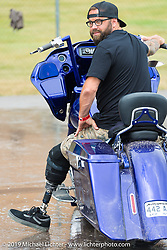 Michael Pierce at the free Bikewash area at the Harley-Davidson downtown display during the annual Sturgis Black Hills Motorcycle Rally. Sturgis, SD, USA. August 6, 2014.  Photography ©2014 Michael Lichter.