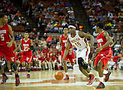 Ben Emelogu (15) of South Grand Prairie brings the ball up the court against Fort Bend Travis during the UIL 5A state championship game at the Frank Erwin Center in Austin on Saturday, March 9, 2013. (Cooper Neill/The Dallas Morning News)