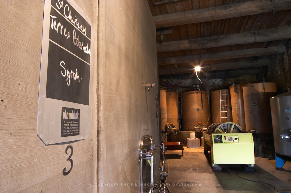Domaine Borie la Vitarèle. Syrah, Terres Blanches Causses et Veyran St Chinian. Languedoc. Concrete fermentation and storage vats. Sign on tank. Wine press. France. Europe.
