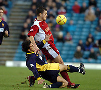 Picture: Henry Browne.<br />Date: 13/12/2003.<br />Wimbledon v Walsall Nationwide First Division.<br />Rob Gier of Dons is pushed down by Gary Birch of Walsall