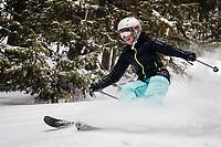 Josie White skis the trees in Hidden Canyon near Brighton Ski Area, Wasatch Mountains Utah.