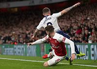 Football - 2018 / 2019 EFL Carabao Cup (League Cup) - Quarter-Final: Arsenal vs. Tottenham Hotspur<br /> <br /> Aaron Ramsey (Arsenal FC) slides into Kieran Trippier (Tottenham FC)  from behind at The Emirates.<br /> <br /> COLORSPORT/DANIEL BEARHAM