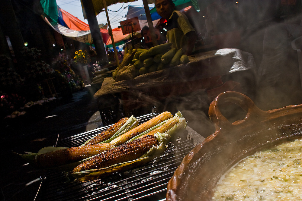 Corn is grilled for sale in Jamaica market, Mexico City.