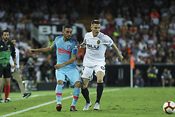 August 20, 2018 - Gameiro of Valencia and  Correa of Atletico de Madrid in action during the spanish league, La Liga, football match between ValenciaCF and Atletico de Madrid on August 20, 2018 at Mestalla stadium in Valencia, Spain. (Credit Image: © AFP7 via ZUMA Wire)