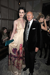 ERIN O'CONNOR and HAROLD TILLMAN at a party for Yves Saint Laurent's Creative Director Stefano Pilati given by Colin McDowell held at The Connaught Bar, The Connaught, Mount Street, London on 29th October 2008.