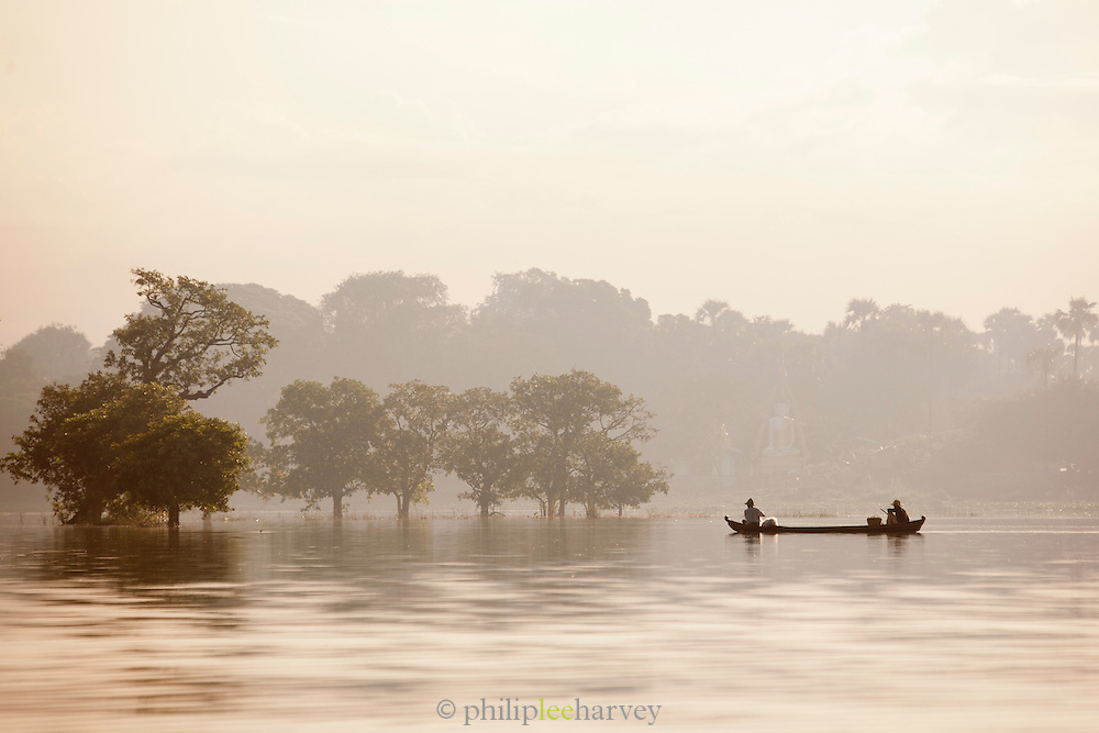 Fishermen in their boats on the Irrawaddy River, near Mandalay, Myanmar