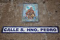 Ornamental street signs for Calle Del Hno Pedro in Antigua, Guatemala.