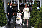 Federal Reserve Board Chairman Alan Greenspan and his new bride NBC Television correspondent Andrea Mitchell pose for photos outside the The Inn in Little Washington, Virginia after their wedding April 6, 1997. Standing with the couple is seven-year-old flower girl, Lauren Hunt who is Mitchell's goddaughter.