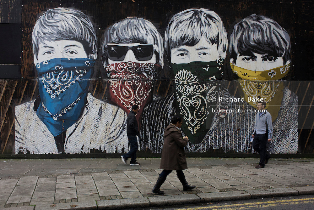 Fab Four art Beatles' faces peer from criminal scarves on street mural by artist Mr Brainwash at the Old Sorting Office, New Oxford Street, London. Mr. Brainwash is the moniker of Los Angeles-based filmmaker and Pop artist Thierry Guetta.
