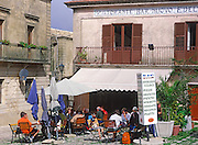 Cafe tables people eating lunch main square, Erice, Sicily, Italy