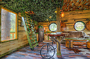 FULFILL YOUR HOBBIT DREAMS BY RENTING OUT THIS AWESOME TREEHOUSE<br /> <br /> In Black Hills, South Dakota, there's a geeky house that's been remodeled to look like a Hobbit's humble abode. Although this one's not located on the side of a hill, but rather, on top of a tree!<br /> Part of Chateau De Soleil, a six-acre property owned by LOTR fan Gordon Mack, the Hobbit Tree House is perched 16 feet above ground and features Middle Earth-themed items like Elvish-language signs, a mask worn by Sauron, and of course, a round door. Oh, and it even comes with Hobbit slippers if you really want to get into it while having second breakfast.<br /> <br /> No need to be a wizard or a bunch of unwelcome dwarves to stay in this property. You just need to rent out the country house (which is also cool with its own arcade) adjacent to it. <br /> ©Lisa Duncan/Exclusivepix Media