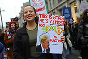 A woman with a Boris Johnson banner at the Bread and Roses Womens March on January 19, 2019 in London, England.  The event was dubbed the Bread and Roses March based on the strikes of the same name by textile workers in Massachusetts in 1912 and Bread and Roses is the title of a poem by American poet James Oppenheim about the strikes.