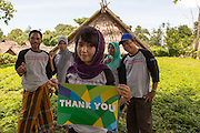 Members of the village's emergency preparedness team pose for a photograph holding a 'Thank you' sign in Gumantar, Kayangan subdistrict, North Lombok district, West Nusa Tenggara province, Indonesia. In the picture are (from left to right) Yurdin, 51; Feni Ratnasari, 21; Titin, 21; Miniati, 21; and Rusman, 41.