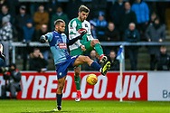 Plymouth Argyle midfielder Graham Carey (10) tackles Wycombe Wanderers midfielder Curtis Thompson(18) during the EFL Sky Bet League 1 match between Wycombe Wanderers and Plymouth Argyle at Adams Park, High Wycombe, England on 26 January 2019.