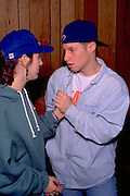 Couple age 18 holding hands volunteers Christmas soup kitchen.  Minneapolis Minnesota USA