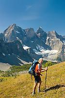 Hiker at Goodsir Pass, Mount Goodsir 3567m (11,703') in the background, Kootenay National Park British Columbia Canada