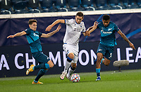 SAINT-PETERSBURG, RUSSIA - OCTOBER 20: Hans Vanaken of Club Brugge KV takes on Daler Kuzyayev [left] and Wílmar Barrios [right] of Zenit St Petersburg during the UEFA Champions League Group F match between Zenit St Petersburg and Club Brugge KV at Gazprom Arena on October 20, 2020 in Saint-Petersburg, Russia [Photo by MB Media]