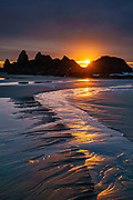 Sunset behind sea stacks reflects in Hill Creek near Seal Rock State Recreation Site, on the Oregon coast, USA. We stayed at the adjacent Seal Rocks RV Cove.