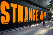 The words Strange Days are written in large orange lettering as part of Strange Days, an video arts exhibition, on 3rd October 2018, in London, England. Strange Days: Memories of the Future, is a new exhibition presented by New York's New Museum and The Store X in partnership with The Vinyl Factory, at London's The Store X, 180 The Strand. The Massimiliano Gioni-curated exhibition features work by some of the world's most exciting film-makers and video artists, presented as large-scale, multi-screen video installations, many of which are being shown in the UK for the first time.