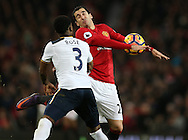 Henrikh Mkhitaryan of Manchester United tussles with Danny Rose of Tottenham during the English Premier League match at Old Trafford Stadium, Manchester. Picture date: December 11th, 2016. Pic Simon Bellis/Sportimage