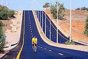 Bicycle rider on an empty motorway