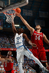 CHAPEL HILL, NC - JANUARY 27: Theo Pinson #1 of the North Carolina Tar Heels is defended by Omer Yurtseven #14 of the North Carolina State Wolfpack on January 27, 2018 at the Dean Smith Center in Chapel Hill, North Carolina. North Carolina lost 95-91. (Photo by Peyton Williams/UNC/Getty Images) *** Local Caption *** Theo Pinson;Omer Yurtseven