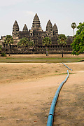 A water pipe draining into the lake beside the ancient Angkor Wat temple, Siem Reap, Cambodia.  Angkor Wat is one of UNESCO's world heritage sites. It was built in the 12th century and covers 162 hectares.  It is Cambodia's main tourist attraction.
