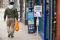 © Licensed to London News Pictures 28/04/2021. Whitstable, UK. Covid warning signs in the High Street. People in Whitstable High Street in Kent wearing masks to protective themselves against the threat of Coronavirus. Photo credit:Grant Falvey/LNP