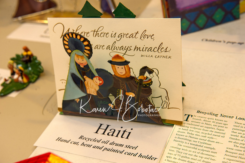 Rev. John Eaton's collection of nativity scenes includes this card holder from Haiti using recycled oil drum steel.  It is one of the 100 nativity scenes from around the world on display at the Meredith Bay Colony Club through Sunday.  (Karen Bobotas/for the Laconia Daily Sun)