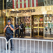 Security guards stand alert outside Trump Tower during the Phase 4 reopening on Monday, August 3, 2020 in New York, New York. Mayor de Blasio is asking travelers from 34 states and Puerto Rico, where COVID-19 infection rates are high, to quarantine for 14 days after arriving in the city.  (Alex Menendez via AP)