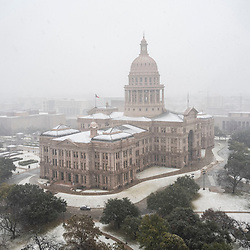 Austin, Texas USA Jan 10, 2021:  The Texas Capitol is shrouded in fog and snow during a rare January snowfall in the Texas Capitol.  About a month later Texas was walloped again by another severe storm that knocked out power to much of the state.