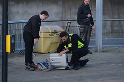 © Licensed to London News Pictures. 17/10/2019. London UK: Police question and search commuters at Canning Town station this morning after XR protesters climbed on top of a train causing delays  , Photo credit: Steve Poston/LNP