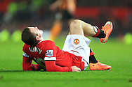 Wayne Rooney of Manchester United lies in pain following falling into the advertising boards - Manchester United vs. Hull City - Barclay's Premier League - Old Trafford - Manchester - 29/11/2014 Pic Philip Oldham/Sportimage