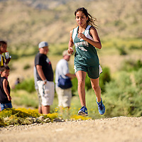 Wingate Bear Chantel Yazzie pushes to the finish line in first place at the Tohatchi Invitational Cross Country meet in Tohatchi Friday.