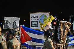 JOHANNESBURG, SOUTH AFRICA - APRIL 26: Cubans welcome an SAA flight with a Cuban Health Brigade, consisting of 217 Cuban Health proffesionals who arrived at Waterkloof Airforce Base. on April 26, 2020 in Johannesburg South Africa. Under pressure from a global pandemic. President Ramaphosa declared a 21 day national lockdown extended by another two weeks, mobilising goverment structures accross the nation to combat the rapidly spreading COVID-19 virus - the lockdown requires businesses to close and the public to stay at home during this period, unless part of approved essential services. (Photo by Dino Lloyd)