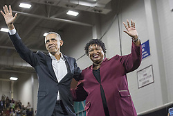 November 2, 2018 - Macon, Georgia, U.S. - Former President BARACK OBAMA and Georgia gubernatorial candidate STACEY ABRAMS wave to the crowd following a rally in Forbes Arena at Morehouse College. (Credit Image: © Alyssa Pointer/Atlanta Journal-Constitution/TNS via ZUMA Wire)