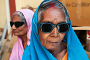 Bihar India March 2011. Akhand Jyoti Eye hospital, Mastichak. Two cataract patients come back two weeks after their operation to have their eyes checked.