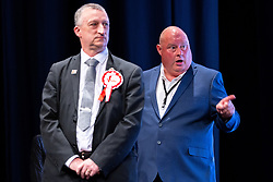© Licensed to London News Pictures . 08/05/2021. Manchester, UK. Independent Candidate DAVID JOHN SUTCLIFFE (right) makes a libellous accusation at the newly elected Mayor , Andy Burnham , at the declaration . The count in the election for the Metro Mayor of Greater Manchester takes place at the Manchester Central Convention Centre (formerly NHS Nightingale NW , formerly GMEX, formerly Manchester Central Railway Station). Photo credit: Joel Goodman/LNP