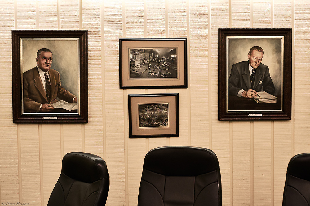 Portraits of company's founders J.D. Genger (left) and Ivan L. Johnson (right) with historic photos of the foundry (center).