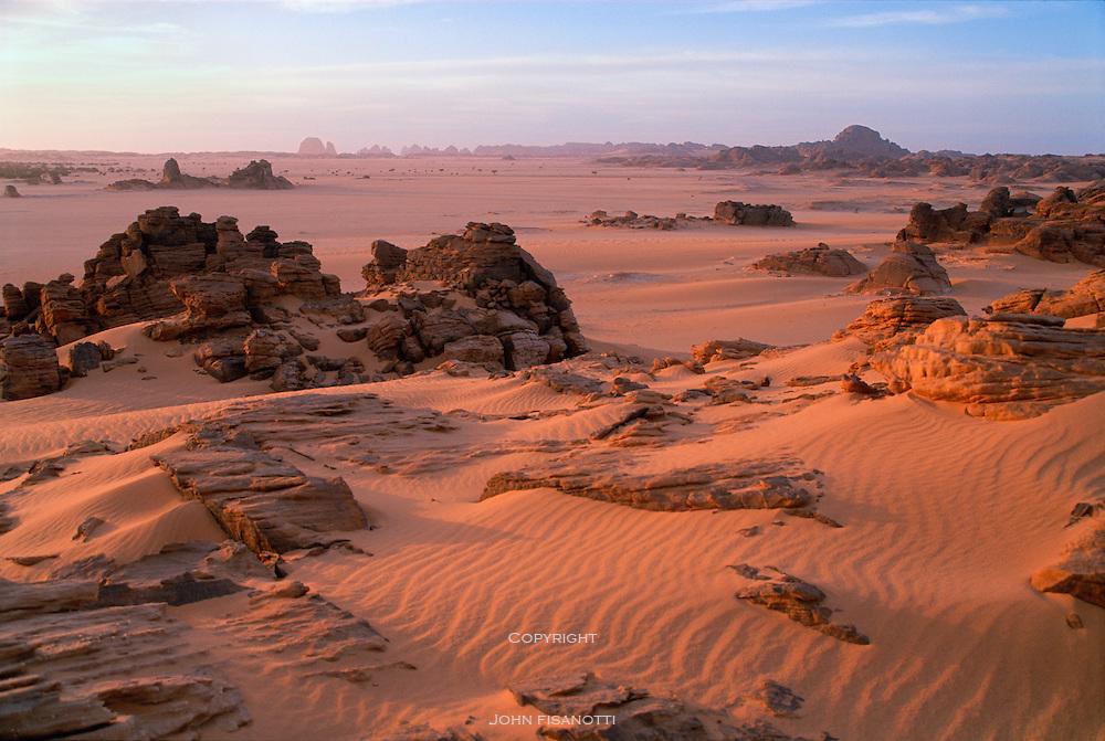 The setting sun illuminates the Djado Plateau of the Sahara Desrt in northeastern Niger