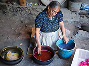 Candlemaker Dona Viviana making a wax flower in the Zapotec village of Teotitlan del Valle, Oaxaca, Mexico on 27 November 2018